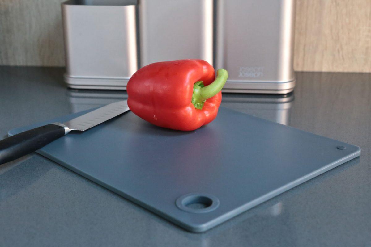 Joseph Joseph CounterStore Kitchen Worktop Organiser chopping board and red pepper